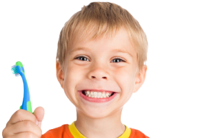 Photo of a Smiling Child Holding a Toothbrush