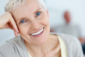 Photo of Senior Woman Smiling with Dentures